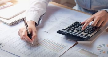 finance and accounting concept. business woman working on desk u